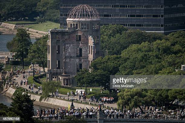 People are seen visiting the Atomic Bomb Dome at the Hiroshima Peace Memorial Park on August 5 2015 in Hiroshima Japan Japan is preparing to mark the...