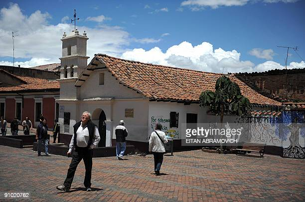 People are seen visiting the El Chorro de Quevedo square in the historic neighborhood of La Candelaria in Bogota on September 17 2009 La Candelaria...