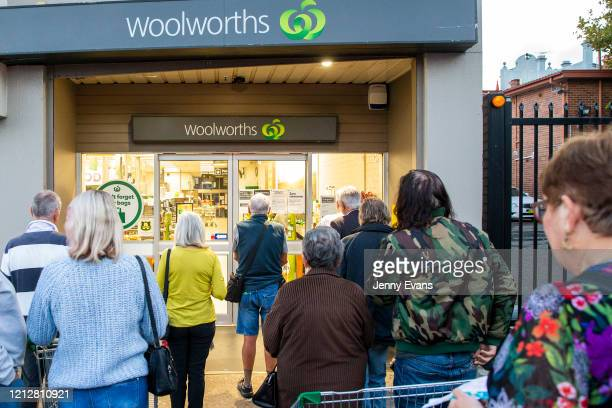 People are seen waiting for the opening of Woolworths supermarket in Balmain on March 17 2020 in Sydney Australia Australian supermarket chains...