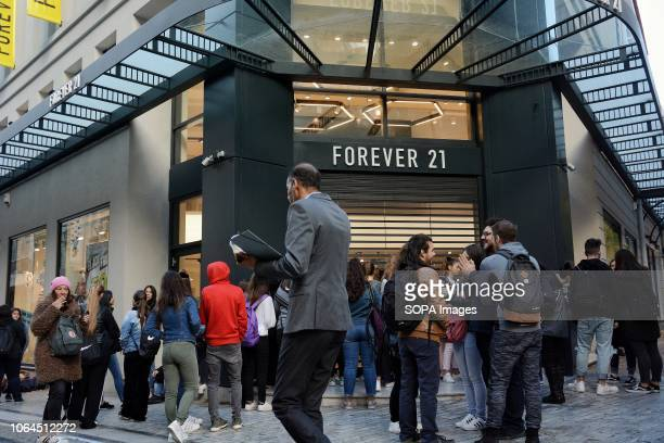 People are seen walking in forever 21 shop, due to the Black Friday discounts at the Ermou Street in Athens.