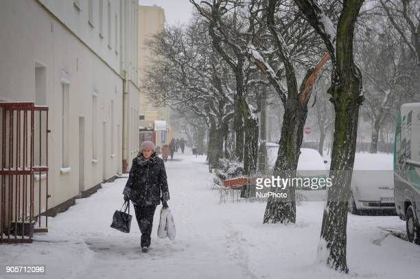 People are seen walking in the snow in Bydgoszcz Poland on January 16 2018 More snow is expected for the coming days across the country and...