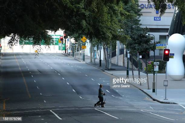 People are seen walking near the Brisbane CBD after lockdown on July 31, 2021 in Brisbane, Australia. Eleven local government areas in south-east...