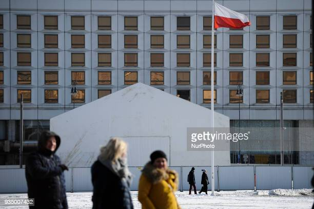 People are seen walking past a tent containg the soon to be revealed monument commemorating the Smolensk Russia government plane crash which killed...