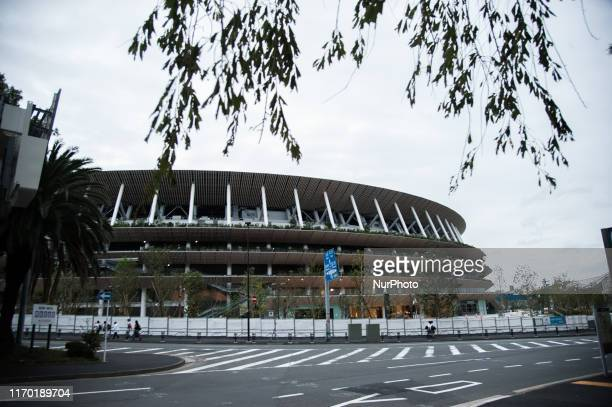 People are seen walking past the building of the Olympic Stadium of Tokyo who will host the Tokyo Olympic Games 2020 Daily life in Tokyo Japan on...