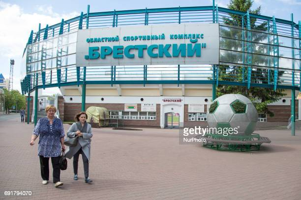 People are seen walking past the entrance of regional sports complex Brestsky in Brest on 1 June 2017