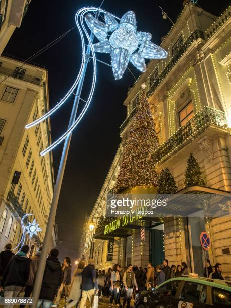 People are seen walking under Christmas and New Year light displays in Armazens do Chiado and Rua Nova do Almada on December 9 2017 in Lisbon...