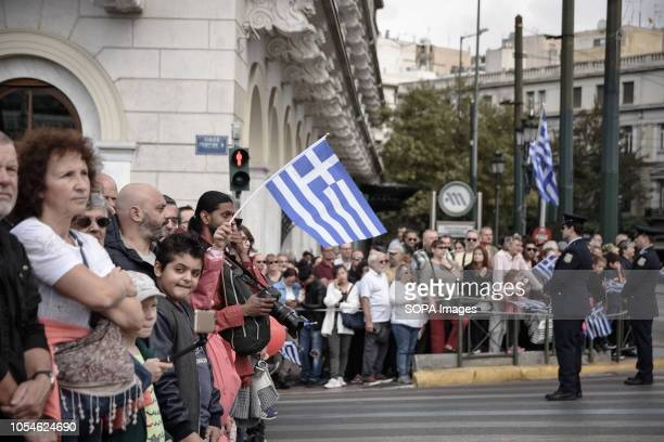 People are seen watching the student parade during the celebrations The national Oxi Day commemorates the rejection by Greek Prime Minister Ioannis...
