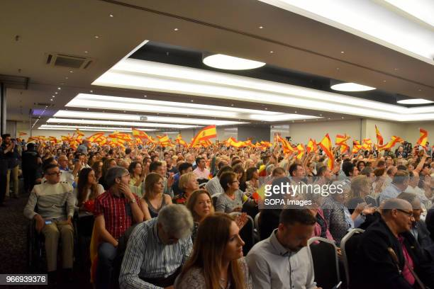 People are seen waving flags in the interior of the Hotel Barcelona Sants where some 1500 people attended the VOX political party in Barcelona VOX...