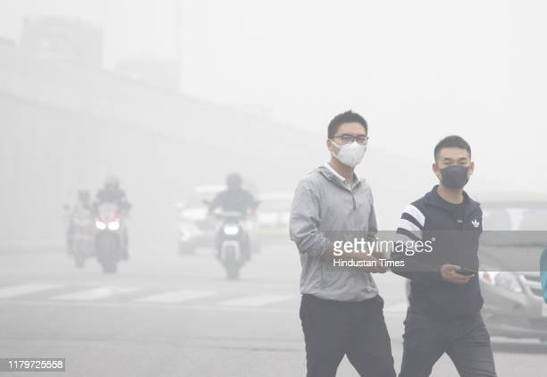 People are seen wearing a face mask due to rise in pollution, on November 3, 2019 in Gurugram, India. The air quality index hit 473 at 9 am,...