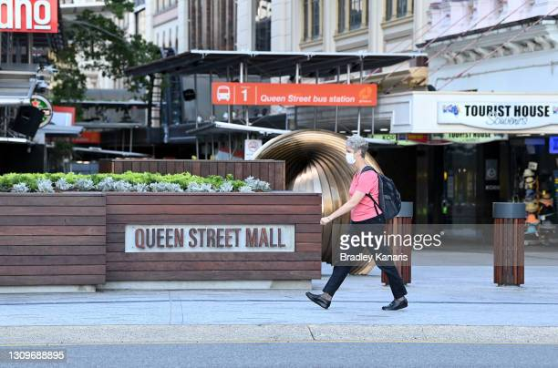 People are seen wearing face masks on the Queen Street Mall in the Brisbane CBD after Queensland Premier Annastacia Palazczuk announced a three-day...