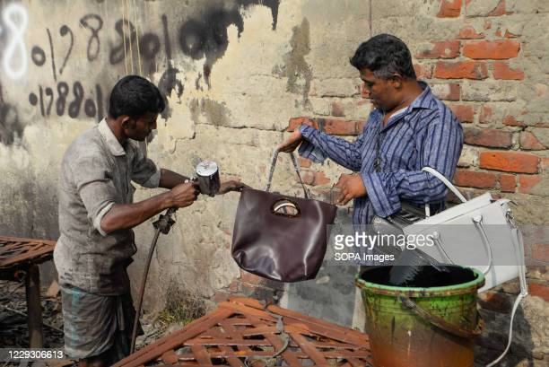 People are seen working at a tannery factory in Hazaribagh. Most people in this area have become victims of pollution due to the presence of toxic...