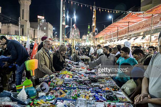 People are shopping as they attend the birthday celebrations of the founder of the Badawiyyah Sufi order Ahmad alBadawi at Ahmad AlBadawi Mosque in...