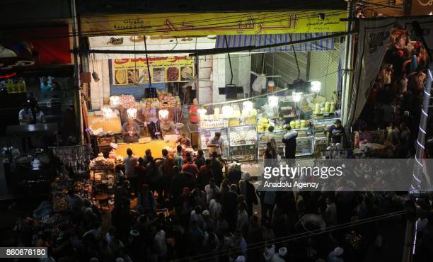 People are shopping as they attend the birthday celebrations of the founder of the Badawiyyah Sufi order Ahmad alBadawi at Seyyid AlBadawi Mosque in...