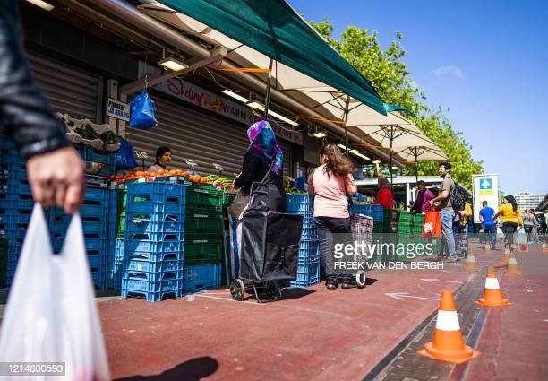 People are shopping at an open market in The Hague in preparation for the celebration of Eid Al Fitr, on May 23, 2020. / Netherlands OUT