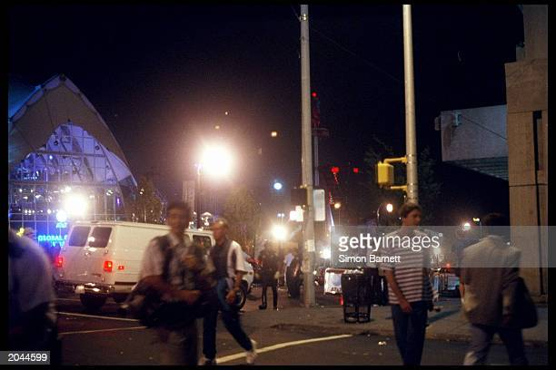 People are shown on the street at the bomb scene outside the ATT Pavillion in the Centennial Olympic Park during the 1996 Centennial Olympic Games...