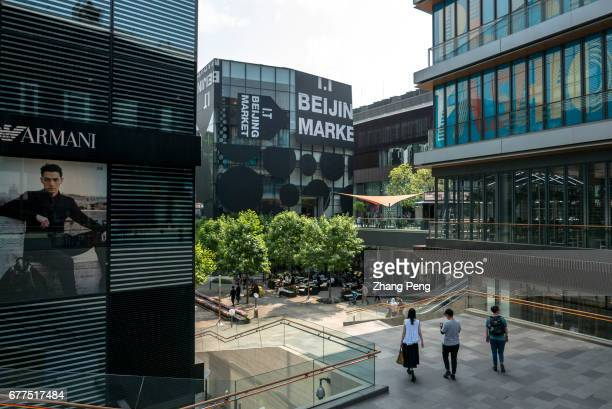 People are sightseeing and shopping in Sanlitun Sanlitun is the fashion and business landmark in Beijing