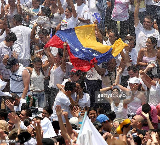 People are sprayed with water as they wait for the start of the Concert for Peace held at the Simon Bolivar bridge in Cucuta in the Colombian border...
