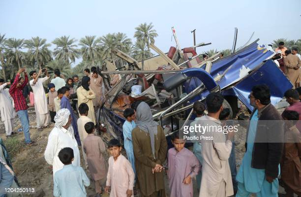 People are standing near the accident site were a train hit a passenger bus which was coming from Karachi at Rohri Railway crossing in which more...