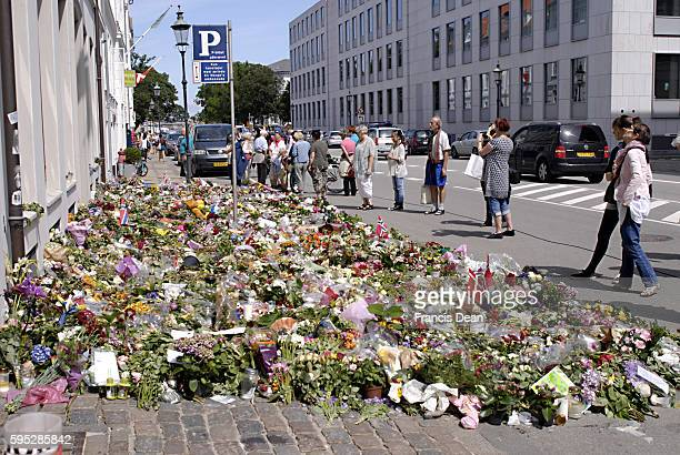 People are still pouring at Embassy fo Norway in Copenhagen with flowersdanish and norwegian flags and message show their solidaty with Norwegain...