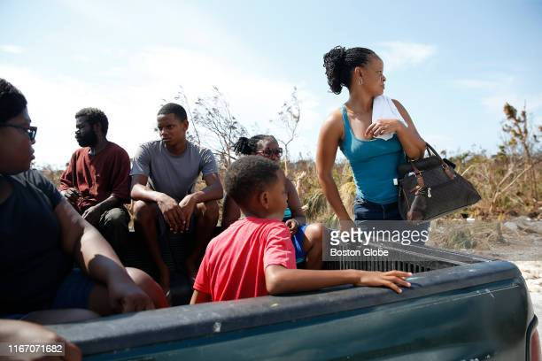 People are stopped before a large portion of road which had been swept away by Hurricane Dorian in Freeport Grand Bahama on Sep 6 2019 Across the...