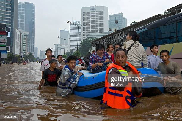 People are stranded by floodwaters in Jakarta's central business district on January 17 2013 in Jakarta Indonesia Thousands of Indonesians were...