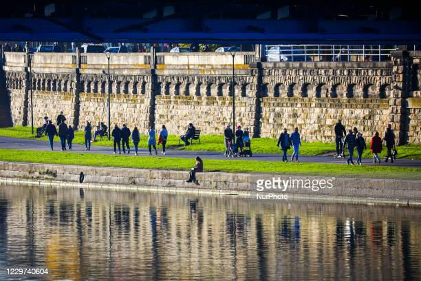 People are strolling along Vistula Boulevards during coronavirus pandemic Krakow Poland on November 11 2020 Tougher measures to battle COVID19 came...