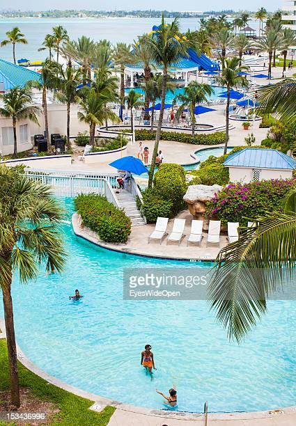 People are swimming at a hotel pool close to the beach on June 15, 2012 in Nassau, The Bahamas.