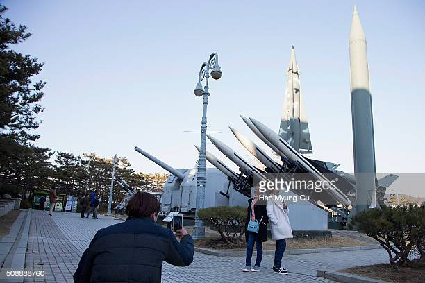 People are taking pictures with a display of model missiles including a North Korean ScudB at the War Memorial of Korea on February 7 2016 in Seoul...