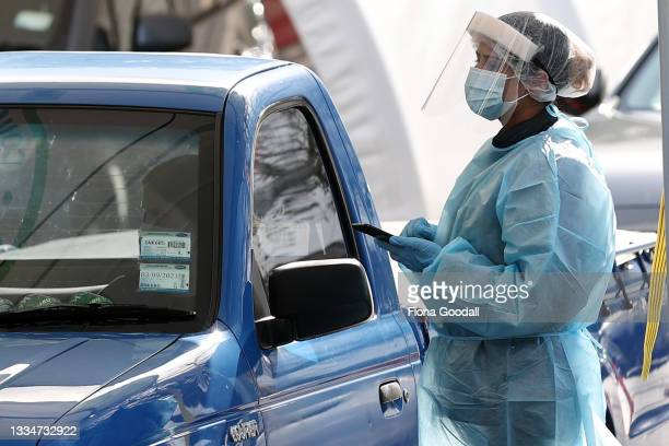 People are tested at a Covid 19 testing station in College Rd, Northcote on August 18, 2021 in Auckland, New Zealand. Level 4 lockdown restrictions...