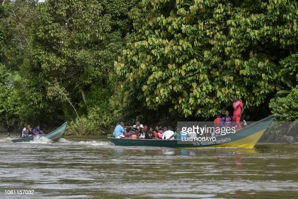 People are transported in a boat on the Micay River in the rural area of the municipality of Lopez de Micay department of Cauca western Colombia near...