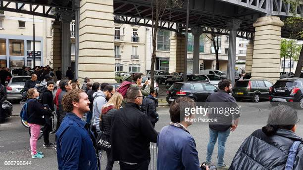 People are trying to see actor Tom Cruise as he is seen on set for 'MissionImpossible 6 Gemini' filming on April 10 2017 in Paris France