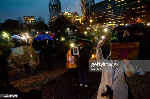 People are turning on the lights of their mobiles, in solidarity with Polish women, during the protest against the abortion ban In Poland, that took...