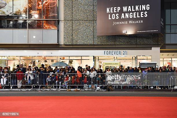 People are waiting for begining of 85th Hollywood Christmas Parade in Hollywood CA United States on November 27 2016 Parade brings marching bands...