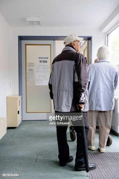 People are waiting for the vote at a polling station during German federal elections on September 24 2017 in Halle Germany German Chancellor and...