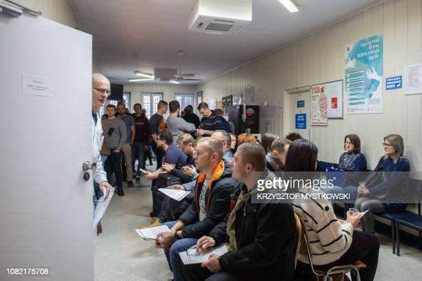 People are waiting to donate blood for Gdansk's mayor at blood donation station in Gdansk on January 14 2019 A knifewielding assailant stabbed Pawel...