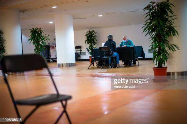 People are waiting to get vaccinated at the Cannes Palace of Festivals and Conferences on January 13, 2021 in Cannes, France. The Cannes Palace of...