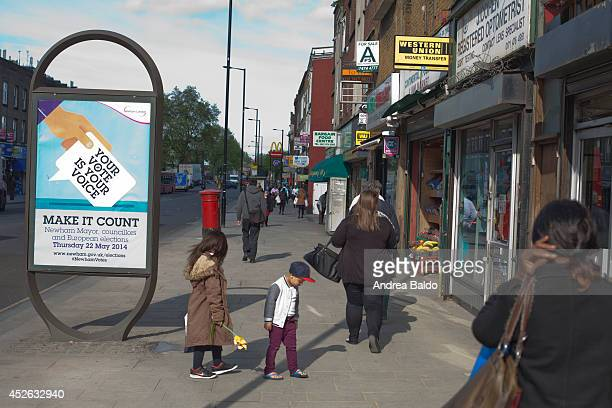 People are walking in Barking Road in Canning Town East London