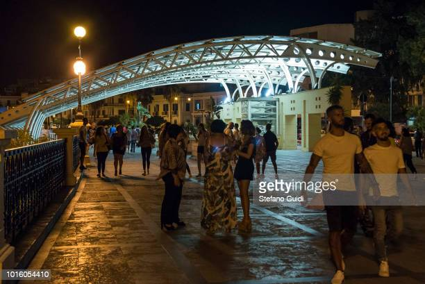 People are walking on the Via Marina near the Lido station during the nightlife in the Via Marina The Via Marina of Reggio Calabria consists of the...