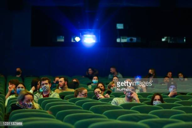 People are watching a movie in a screening room of Kino Kijow cinema on the first day od reopening after lockdown due to the spread of coronavirus...