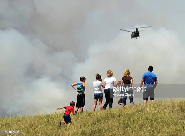 People are watching the Black Forest fire Colorado Springs Colorado June 12 2013 According to El Paso County Sheriff Terry Maketa the Black Forest...