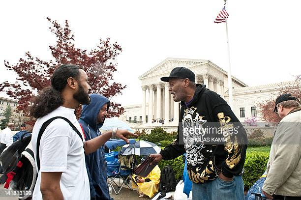 People argue about their place in the line in front of the US Supreme Court in Washington on March 24, 2012 as they queue to hear arguments on US...
