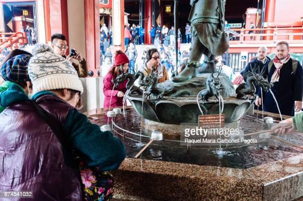 People around fountain in Sensoji temple
