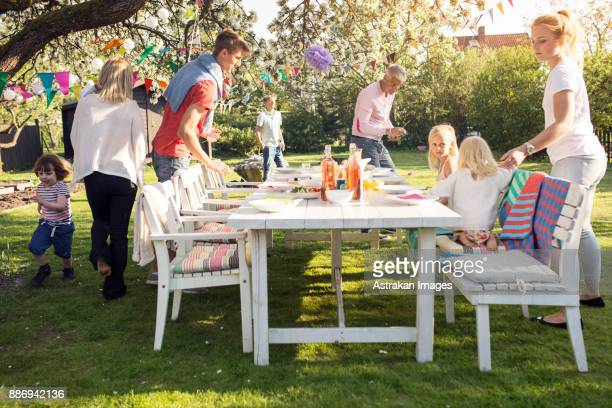 People around table at garden party