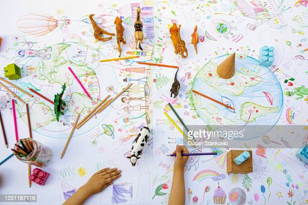 people around the world sharing love, children's drawing - social justice concept stock pictures, royalty-free photos & images
