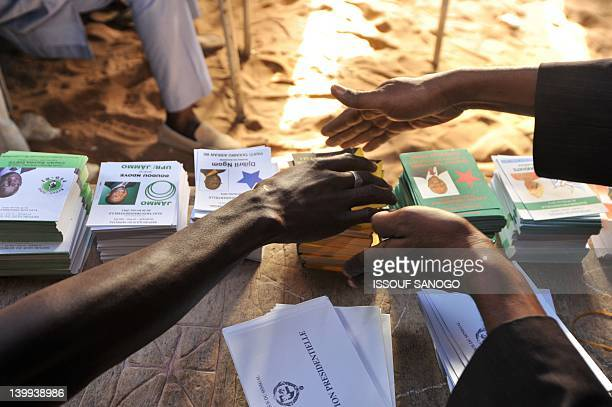 People arrange ballots on a table on February 26 2012 at a polling station in Dakar during Senegal's most contentious election yet as President...
