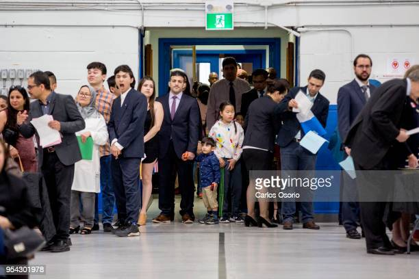 People arrive at a citizenship ceremony held at the Royal Canadian Navy local reserve division HMCS York