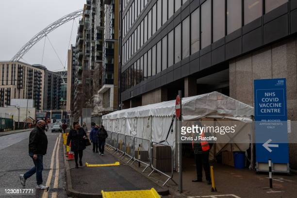 People arrive at a Covid-19 vaccination centre near Wembley Stadium on January 27, 2021 in London, United Kingdom. AstraZenecas chief executive has...
