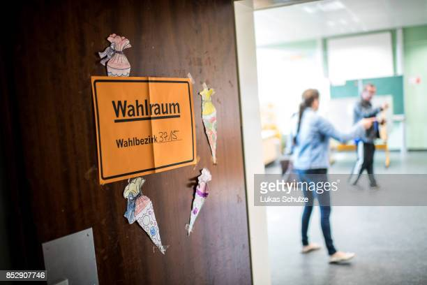 People arrive at a polling station in a school during German federal elections on September 24, 2017 in Duesseldorf, Germany. German Chancellor and...