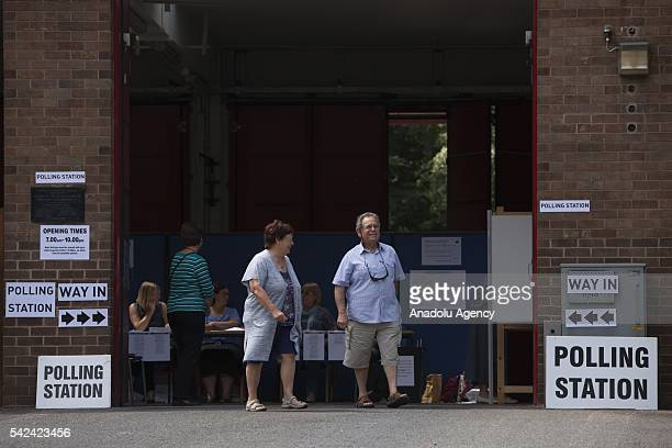 People arrive at a polling station to cast their votes in the EU Referendum in Manchester United Kingdom on June 23 2016 Voting has begun in the...