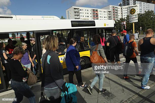 People arrive at a public bus station in Marzahn district on September 21 2016 in Berlin Germany In Berlin state elections held three days before the...